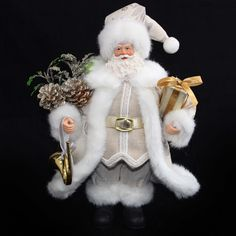 Standing Santa holding gifts. This Santa looks very cheerful as he delivers presents at Christmas.  Colour:Ivory/silver/gold Product type:ChristmasCollectableSize: 30cmMade of:FabricCode:3436295