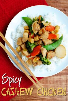 Spicy Cashew Chicken is fresh veggies stir fried with juicy chicken and salty cashews then swirled in a mouthwatering spicy, garlicky sauce. | iowagirleats.com