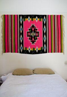 A textile headboard in the Santa Barbara carriage house of an artist couple.