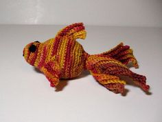 Orange Catnip Fishy is happy.  knitted by summersong.