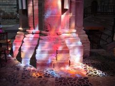 Colored light bathes the interior of Saint-Julien in Brioude, France. Used to illustrate John 3:16-21. Those who do what is true come to the light, so it may clearly be seen that their deeds have been done by God.