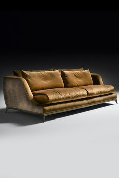 A statement of outstanding sophistication and elegance, a truly timeless piece. Upholstered to the highest standard in two perfectly contrasting earthy tonal fine quality rich velvets, on an industrial style modern brushed bronzed metal base with defined striking structural detailing. The Contemporary Designer Velvet Sofa is the epitome of comfort, enveloping you in softness. The design of this exquisite sofa would suit both a classic or contemporary interior, perfect in any setting…