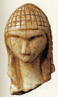 Brassempouy Venus - this miniature head, 36.5 mm high, 22 mm deep and 19 mm wide, was carved from mammoth ivory. Found at Brassempouy, Landes, France in 1892. It may be 25 000 years old. It is one of the few Ice Age figures with facial features and a detailed hairstyle.