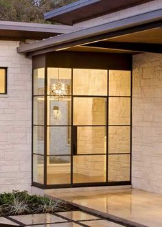 Eye catching entrance for an awkwardly placed front door. Dark bronze finish steel door w/ side lights, transom, and side panel Steel Doors And Windows, Metal Windows, Industrial Windows, Exterior Doors, Entry Doors, Architecture Details, Modern Architecture, Crittall, Building Stone
