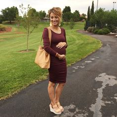 Gold leather earrings, marsala dress, wedges, great maternity style. Love the wavy pixie cut!