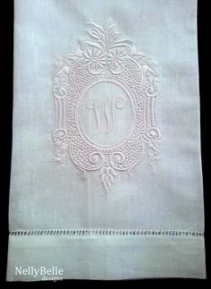 Monogrammed guest towel. Ornate white crest on white cotton/linen guest towel. NellyBelle Designs