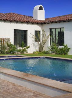 Poolscape - grade change retaining wall/ledge