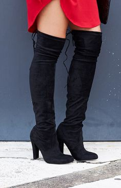 Winter is coming, but that doesn't mean you can't look hot hot hot! The Lipstik Skarlett Boots Black are here to make any outfit look smokin'. Made from a black microsuede fabric, these boots are thigh high with a lace up detail at the back, a slim-block heel and an almond toe. Style over dark skinny jeans with an oversized knit to elongate your legs or pair with your cutest winter dress. You'll have legs for days in the Lipstick Skarlett Boots Black! FABRICATION: Man-Made Upper, Lower And…