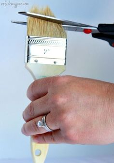 Inexpensive Wax Brush - cutting the bristles of a chip brush will make the bristles firmer, so it makes it easy to use as a wax brush. #chalkpaintedfurniture