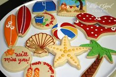 day at the beach star fish, seashell, beach ball, surf board, swim suit cookies cookies