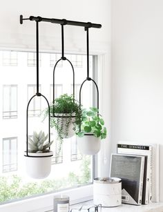 20 stylish hanging planters for small space dwellers - Black hanging planters for windows When your love of greenery is much larger than your home, hanging plants are the way to go. I've handpicked 20 stylish and space-saving planters that can be h Ceramic Wall Planters, Metal Hanging Planters, Hanging Plants, Potted Plants, Hang Plants From Ceiling, Diy Wall Planter, Plants Indoor, Ikea Hanging Planter, Hanging Baskets Kitchen