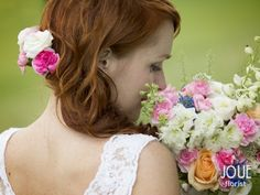Small summer wedding in nature, beautiful bride and with her wedding flower