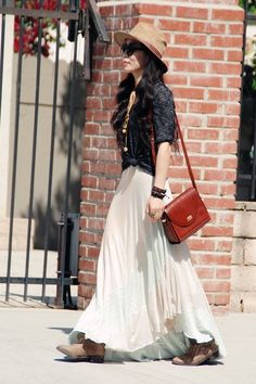 Summer outfit: white maxi skirt, blue blouse, brown booties, shoulder bag, black sunglasses, brown hat and bohemian accesories.
