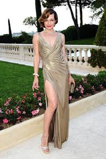 Milla Jovovich looked flawless in the south of France (at the amfAR fete) thanks to her revealing, gold Atelier Versace gown and exquisite b...