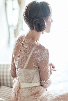 Lace-draped wedding gown. Beautiful back.