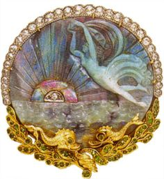 Art Nouveau Brooch/pendant with carved opal, demantoid garnet, diamonds, 18k yellow gold, and platinum, c. 1890. A carved opal depicting a sea nymph with ocean waves by Marcus & Co.