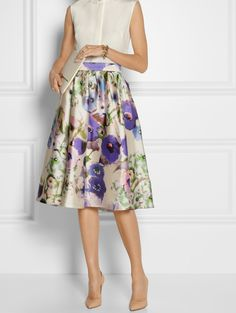 Midi skirt trends - flattering but fuller ones slimming down. Will be around all 2014.