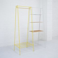 The steel 'A' clothes rail is one of our signature pieces. A stunning addition to any bedroom or hallway, the minimal design looks delicate but is surprisingly robust. Yellow clothes rack.