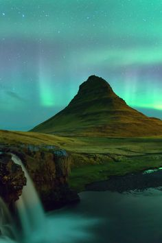 Kirkjufell Iceland - Northern light show by Stefano Savi on 500px