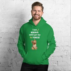 A new hoodie for Yorkshire Terrier dad and parent from our new clothing collection, Almost normal, with white print paws on the left sleeve. #yorkie #yorkshireterrier #yorkieclothes #yorkielover #yorkiehoodie #hoodie #doghoodie