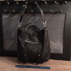 Perlina New York black leather Satchel nice cond. Supple black suede like soft leather satchel w handles. Nice Silver hardware. No wear at all. Zippered pockets with adjustable long strap! Beautiful silver and black animal print cloth inside bag!! Very functional bag! Thanks for looking! Perlina New York Bags Satchels