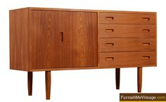 "Mid century modern teak credenza by Poul Hundevad. Credenza bears the makers mark on the back left corner and is stamped ""Made in Denmark."" The unit bears four dovetailed drawers with sculpted teak pulls, and an accordion-like door that opens to reveal open shelving."