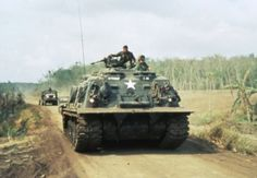 PHUOC TUY PROVINCE, SOUTH VIETNAM. C. 1966. An M88 Armoured Recovery Vehicle Traveilling along a country road.