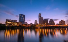View of downtown at night looking across Lady Bird Lake.