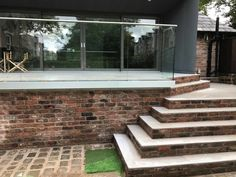 glass balustrades raised patio steps liverpool - Sunrock Balconiesglass balustrades raised patio steps liverpool - Sunrock Ideas For Raised Patio Bifold The price of raising a stone paver patio vs building a composite deck Patio Steps, Garden Steps, Pavers Patio, Patio Plants, Concrete Patio, Balustrades, Glass Balustrade, Glass Balcony, Balcony Garden