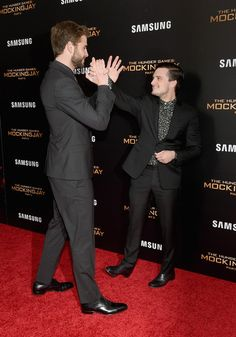 "Liam Hemsworth and Josh Hutcherson attend ""The Hunger Games: Mockingjay- Part 2"" New York Premiere at AMC Loews Lincoln Square 13 theater on November 18, 2015 in New York City."