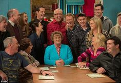 Laughs all round: But Brendan O'Carroll tries to keep a straight face while surrounded by the cast of Mrs Browns Boys.