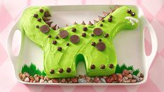 Delight your dino lover with a bright green dinosaur cake and listen for a ROAR of approval.