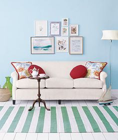 Pair busy accessories with a simple sofa for mutually beneficial results. | Surprising, low-cost ways to update your home décor.