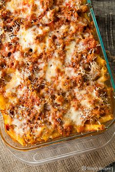 It's a classic! Baked Ziti recipe with ziti pasta, Italian sausage, onions, garlic, Italian seasoning, tomato sauce, Mozzarella, ricotta, and Parm. SO GOOD! On SimplyRecipes.com