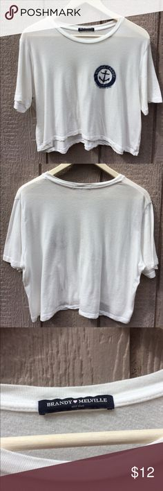 BRANDY MELVILLE CROP TEE IN WHITE WORN ONCE This is a practically brand new and in perfect condition Brandy Melville cropped t-shirt. I say it's cropped on me mainly because I have a long torso and it hits right at my rib cage. I ripped the tags off and tried it on and then stuck it back in my closet. It's really comfy and soft and would look cute with some high waisted shorts this summer. Thank you so much and feel free to ask me anything Brandy Melville Tops Crop Tops