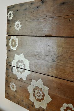 Flower stencils on wood canvas DIY wall art; I want wall art for the living room on my teal wall - this would be awesome! Maybe dragonflies
