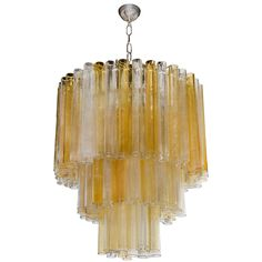 Mid-Century Modernist 3 Tier Amber & Clear Chandelier by Barovier e Toso | From a unique collection of antique and modern chandeliers and pendants  at http://www.1stdibs.com/furniture/lighting/chandeliers-pendant-lights/
