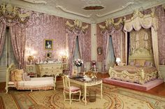 """""""Alva Vanderbilt's bedroom with its silk lampas wall covering and ornamental cherubs, nymphs and gold garlands."""""""