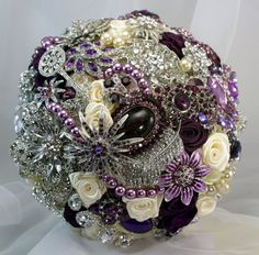 Brooch Bouquet....ask each Shower guest to bring you a brooch in your signature colour.  Then make your bouquet out of them...love
