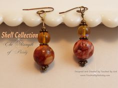 #Jewelry #Earrings #Handcrafted #Shell ~ These Freshwater Pearl earrings are a marbled brown that have deep rich brown hues that complement every skin tone and hair color. Made from Grade A freshwater shells. The french hook ear wires and all components are #Brass which only adds to the beauty! For ladies who want jewelry as fabulous as they are! Visit my shop @ www.TouchedByGod.etsy.com!