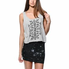 The Empyre Lydia Tribal Grey Crop Tank Top for girls is made with a comfortable blended construction and a wide fit with cropped torso. The solid tribal print graphic at the front contrasts the Heather Grey colorway of this tank top so you get the best in
