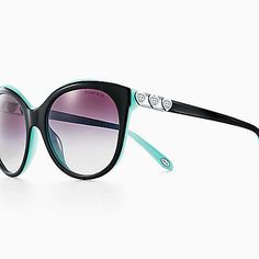 3924cdc3508 Return to Tiffany® Love round sunglasses in black and Tiffany Blue acetate.