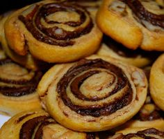 Nutella Pinwheels! They are so cute and versatile. You can make them savory with cheese, onions or even meat . I love them sweet of course, ...