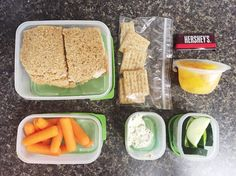 Office lunch day 7: Chicken salad sandwich, baby carrots, sliced cucumbers, peach cup, Triscuits, Alouette spinach and artichoke soft cheese, and a mini dark chocolate Hershey's bar.