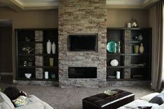 Heat & Glo Cosmo fireplace with Martini Bronze front, Boral Cultured Stone Pheasant Alpine Pro-Fit Ledgestone