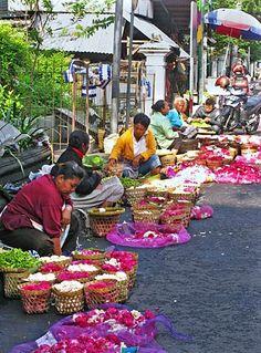 Flower peddlers display their colorful wares near Malioboro Road in Yogyakarta, Indonesia