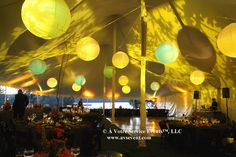 Fabulous textured lighting with lanterns for a tent reception.