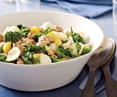 Lower in fat and calories, Italian turkey sausage provides a lighter alternative to beef in this recipe that brings together broccoli rabe and yellow squash for a flavorful meal.