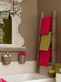 Wooden ladder used as a towel rack! Maybe this one. I might have enough for two ideas.