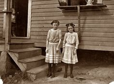 "November 1908: Gastonia, North Carolina. Lacy, 12 years old, and Savannah, 11. Have worked two years. Father said ""The little one is a crackerjack on spinnin', at least so the boss says. She ain't satisfied unless in the mill. The oldest one isn't so good at it. Not as quick."" (Note the tense, serious looks on the younger. Older one more like a real girl.) View full size. Photo and caption by Lewis Wickes Hine."